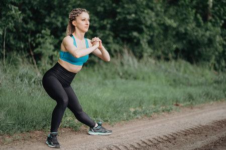 Fit sporty woman in sportswear stretching legs