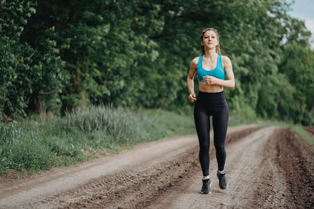 Active woman jogging in the countryside. Sport Stock Photo