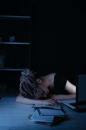 Businesswoman fell asleep near laptop, night work Stock Photo