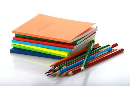 stack of books and twelve crayons photo