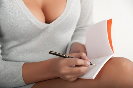 sexy business woman: woman writes