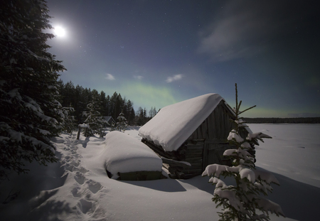 lonliness: Village house in the lights of moon and Aurora borealis. Northern Karelia. Russia.