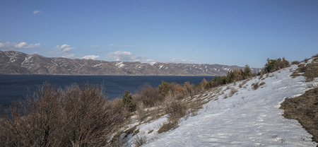 maintains: Panoramic view of Sevan Lake with snow maintains around of it