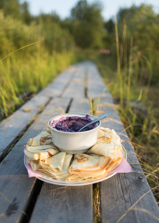Russian pancakes with blueberry jam on the beautiful background Stock Photo