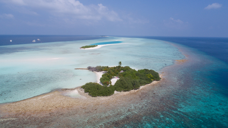 Increadible aerial view on small island in Indian ocean, Maldives Stock Photo