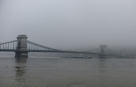 Budapest Danube bridge in a fog at a winter time