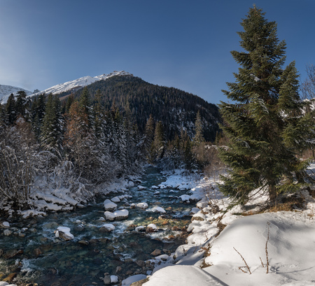 Elbrus mountain river under the snow beautiful daylight landscape Stock Photo
