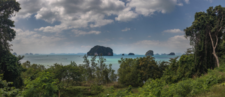 Classic Thailand ocean view with long tail boats, islands, palms, sun and sky, huge 50MP panorama Stock Photo