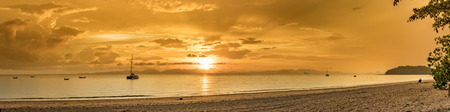 Classic Thailand sunset view with long tail boats, white sand beach, palms, ocean, sun and sky, huge 50 MP panorama Stock Photo