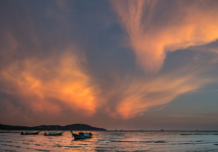Classic Thailand sunset view with long tail boats, white sand beach, palms, ocean, sun and sky, huge 56MP pano