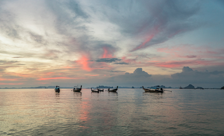 Classic Thailand sunset view with long tail boats, white sand beach, palms, ocean, sun and sky, huge 74MP panorama
