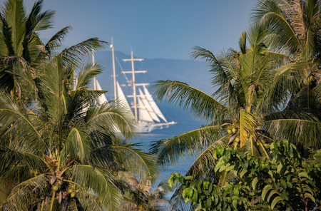 Classic Thailan ocean view with huge sail, palms, blue ocean Stock Photo