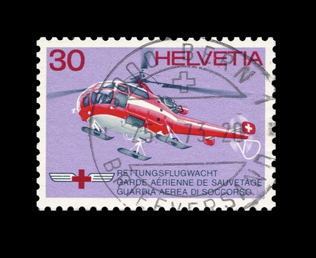 helvetia: Swiss post stamp, stamped, showing swiss rescue helicopter in flight. Helvetia 30 cents
