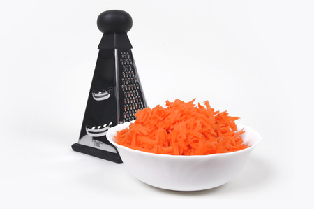Grater and grated carrots Stock Photo