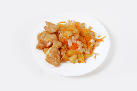 Steamed potatoes and fried fish