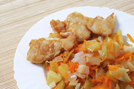 Potatoes and fried fish
