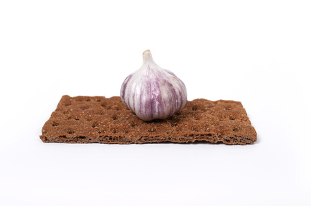 Dietary bread with garlic on white background