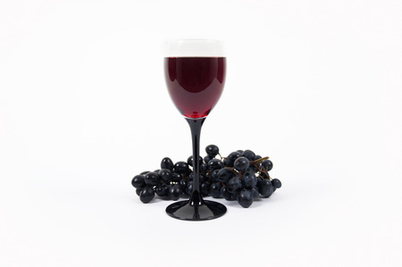 A glass of wine and grapes Stock Photo