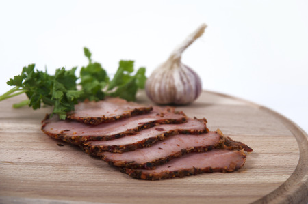 Cutting ham with herbs and garlic