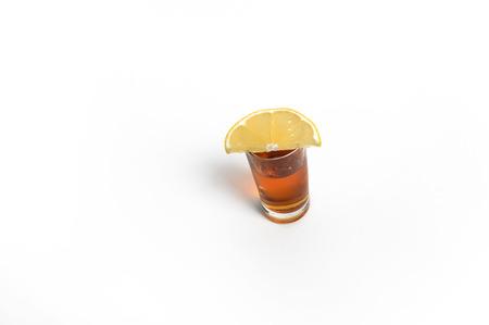 Glass of brandy and lemon