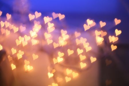 blurry lights: Background of blurry golden hearts Stock Photo