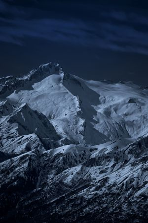 Moonlit high mountain landscape at night in Dolomites (Trentino, Italy) Stock Photo
