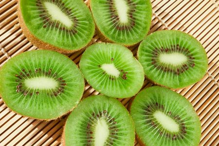 Close-up of fresh kiwi slices forming a flower photo