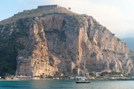 Calm misty morning (View of Terracina port, Italy in the morning with the roman Temple of Jupiter Anxur on the Monte SantAngelo photo