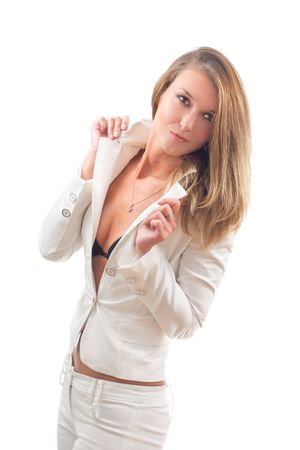 Young sexy businesswoman in white suit posing and looking aside photo