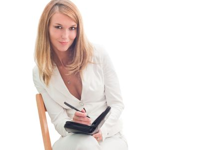 Young beautiful smiling businesswoman making plans, isolated over white photo