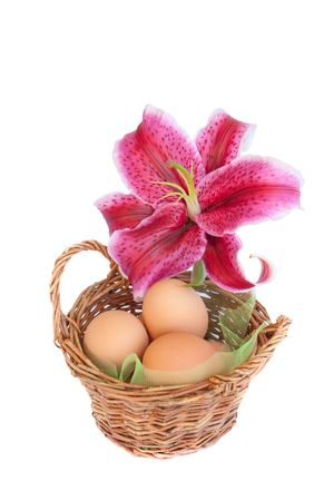 Traditional easter eggs basket with purple lily flower photo