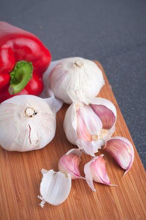 Garlic and paprika on cutting board photo