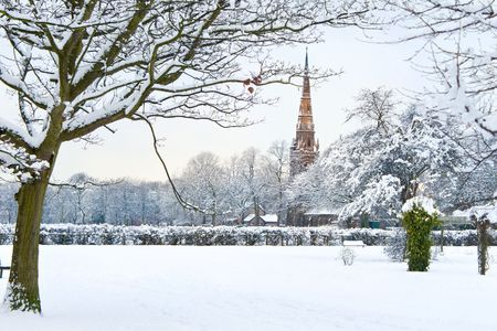 snow on the ground: New English winter series: view of Platt Fields Park in Manchester covered with snow