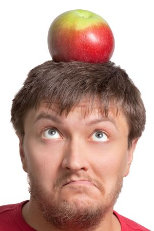 Funny young student with an apple on his head photo