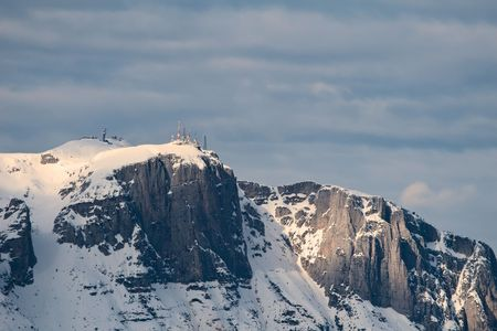 Winter high mountains landscape in Northern Italy: view on the mount Paganello photo