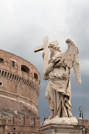 View of Castel Sant`Angelo and one of Bernini`s statue (Angel with the Cross) in Rome photo
