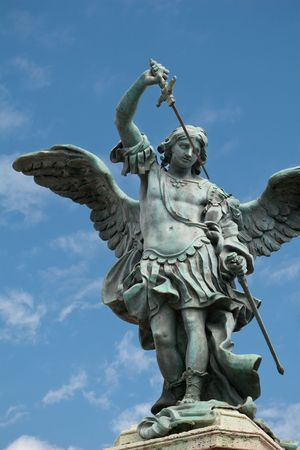 Saint Michael statue on the top of Castel Sant`Angelo in Rome photo