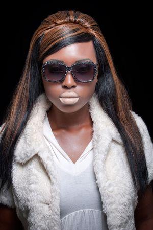 Beautiful elegant black model wearing stylish sunglasses photo