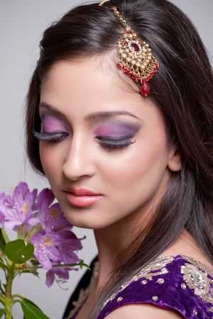 Young asian bride with beautiful makeup photo