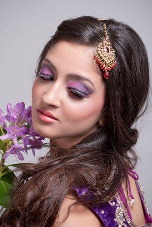 Young asian bride with beautiful makeup photo