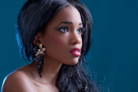 Beautiful black girl, studio portrait on blue background photo