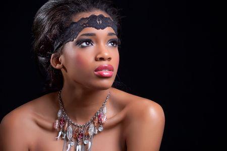 Beautiful black girl, studio portrait on black background photo