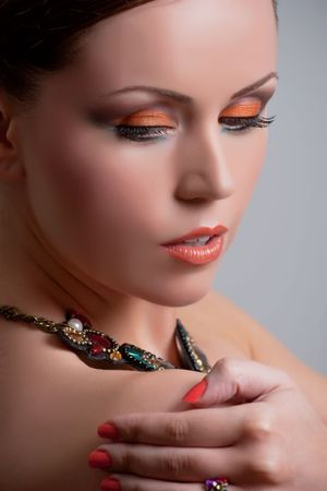 Young woman with beautiful makeup and necklace Stock Photo - 7305037
