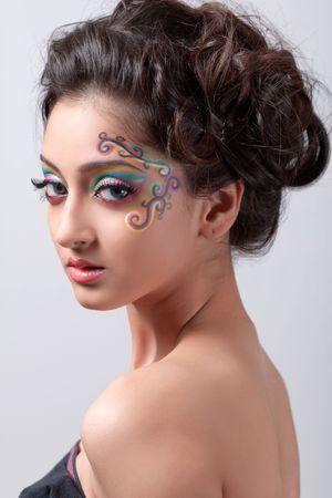 Beautiful young girl with fantasy makeup
