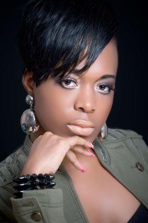 Beautiful black girl wearing a khaki jacket