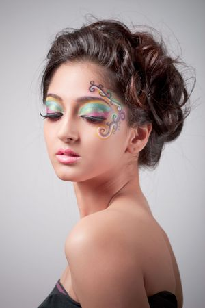 Beautiful young girl with fantasy makeup photo