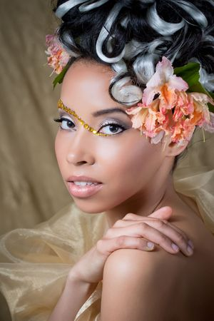 Portrait of a beautiful young girl with curly hairstyle and fantasy makeup