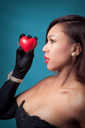 Beautiful young woman holding a heart Stock Photo - 7305043
