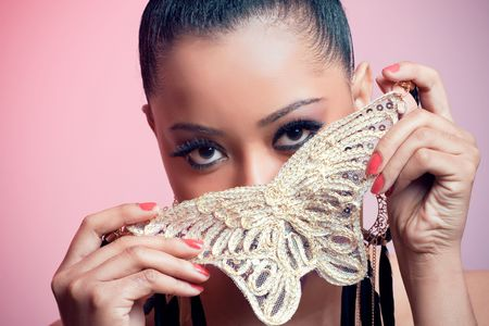 Portrait of a beautiful young woman holding a butterfly photo