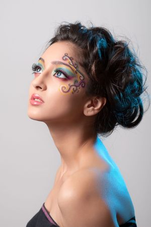 fantasy makeup: Beautiful girl with fantasy makeup and curly hairstyle Stock Photo